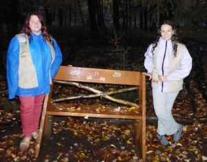 Girl Scouts and bench
