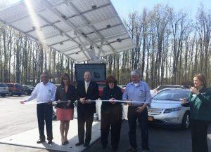 Cutting ribbon at new EV charging station