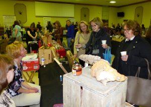 women look at art on display